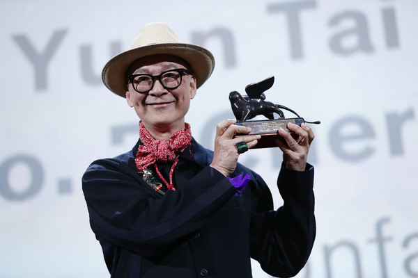 Yonfan receives the Award for Best Screenplay for No.7 Cherry Lane during the Award Ceremony during the 76th Venice Film Festival