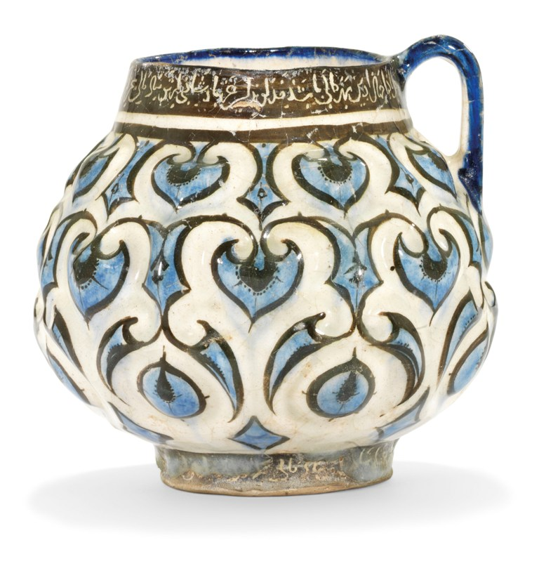 2020_CKS_18371_0004_000(a_kashan_moulded_cobalt-blue_black_and_white_jug_central_iran_early_13_d6255679)