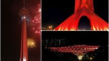 Three iconic structures of Tehran lit up red to mark World AIDS Day