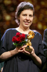 Adina Pintilie_ winner of the Golden Bear for Best Film for _Touch me not_ pose at the closing ceremony during the 68th Berlinale International Film Festival