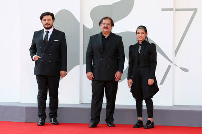 03 Javad Ezzati_ director Majid Majidi and Shamila Shirzad walk the red carpet ahead of the movie Khorshid (Sun Children) at the 77th Venice Film Festival on September 06_ 2020 in Venice_ Italy.
