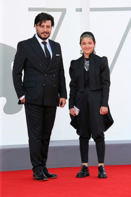 0991 Javad Ezzati and Shamila Shirzad walk the red carpet ahead of the movie Khorshid (Sun Children) at the 77th Venice Film Festival on September 06_ 2020 in Venice_ Italy.