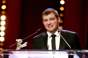Anthony Bajon receives the Silver Bear for Best Actor for _The Prayer_ on stage at the closing ceremony during the 68th Berlinale International Film Festival