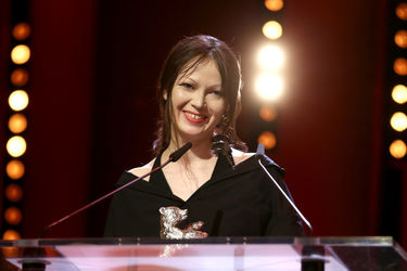 Elena Okopnaya receives the Silver Bear for an Outstanding Artistic Contribution for _Dovlatov_ on stage at the closing ceremony during the 68th Berlinale International Film Festival